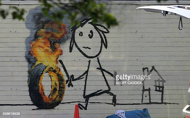 A recently painted mural by British graffiti artist Banksy on a wall at his former school Bridge Farm Primary School in Bristol on June 7 2016 Banksy...