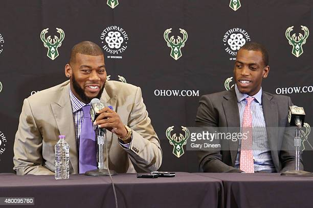 Recently signed free agents Greg Monroe and Khris Middleton of the Milwaukee Bucks are joined by general manager John Hammond and head coach Jason...