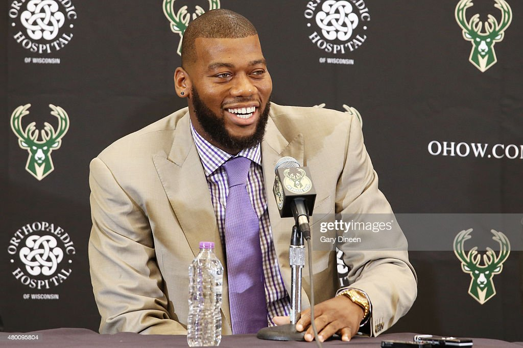 Recently signed free agents <a gi-track='captionPersonalityLinkClicked' href=/galleries/search?phrase=Greg+Monroe&family=editorial&specificpeople=5042440 ng-click='$event.stopPropagation()'>Greg Monroe</a> and Khris Middleton of the Milwaukee Bucks are joined by general manager John Hammond and head coach Jason Kidd during a press conference at the Orthopaedic Hospital of Wisconsin Training Center on July 9, 2015 in St. Francis, Wisconsin.