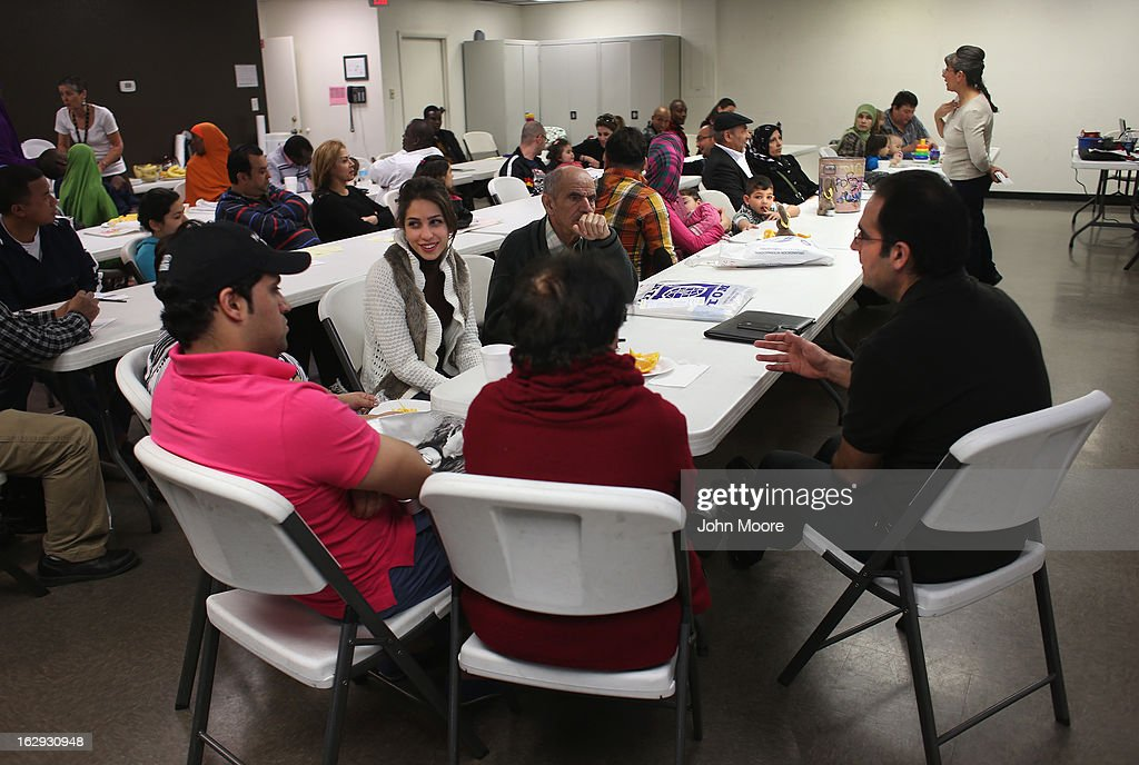 Recently-arrived refugees from Iran learn about how to receive food stamps during a class held by the Arizona Department of Economic Security at the International Rescue Committee (IRC), office on March 1, 2013 in Phoenix, Arizona. IRC programs like many programs that receive federal funding, may be greatly cut back due to federal sequestration cuts. The IRC is a non-profit humanitarian aid organization that aids refugees and survivors of international conflict. They assist new arrivals, many of whom come from refugee camps and war zones, to adjust to American society after being granted refugee status and invited by the U.S. government to live in the United States. The IRC also assists refugees through the immigration and naturalization process to become U.S. citizens.