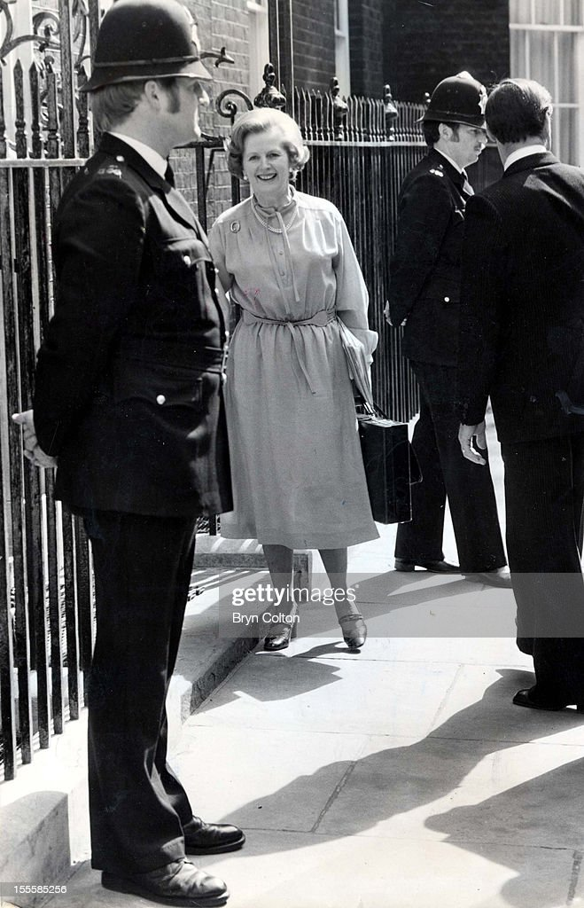 Recently-elected British Prime Minister <a gi-track='captionPersonalityLinkClicked' href=/galleries/search?phrase=Margaret+Thatcher&family=editorial&specificpeople=159677 ng-click='$event.stopPropagation()'>Margaret Thatcher</a> arrives at 10 Downing Street, London, 4th June 1979. With her are police officers and a detective (right).