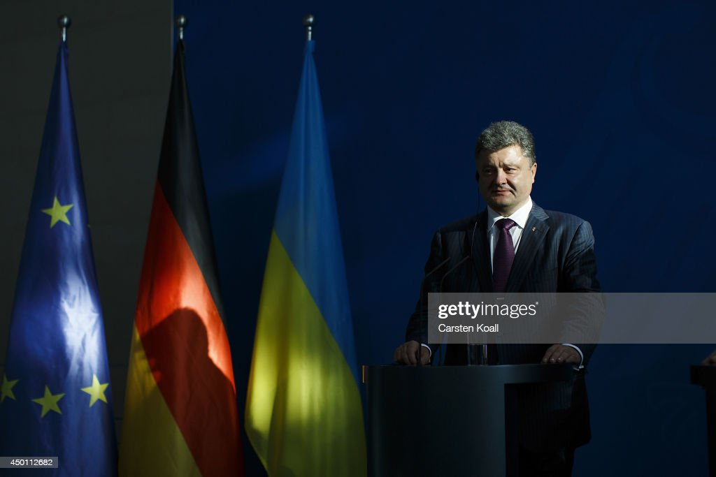 Recently-elected Ukrainian President <a gi-track='captionPersonalityLinkClicked' href=/galleries/search?phrase=Petro+Poroshenko&family=editorial&specificpeople=549382 ng-click='$event.stopPropagation()'>Petro Poroshenko</a> and German Chancellor Angela Merkel (not pictured) give statements to the media prior to talks at the Chancellery on June 5, 2015 in Berlin, Germany. Poroshenko is meeting with western leaders as the situation in eastern Ukraine is descending further into war between government forces and Russian-backed separatists.