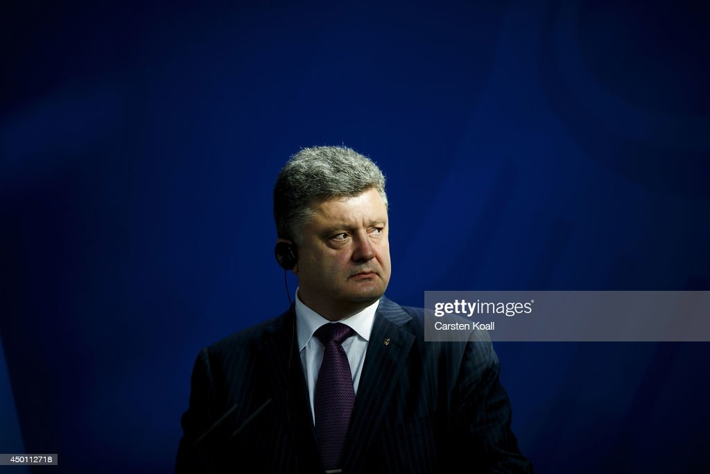 Recently-elected Ukrainian President Petro Poroshenko gives statements to the media together with German Chancellor Angela Merkel (not pictured) prior to talks at the Chancellery on June 5, 2015 in Berlin, Germany. Poroshenko is meeting with western leaders as the situation in eastern Ukraine is descending further into war between government forces and Russian-backed separatists.