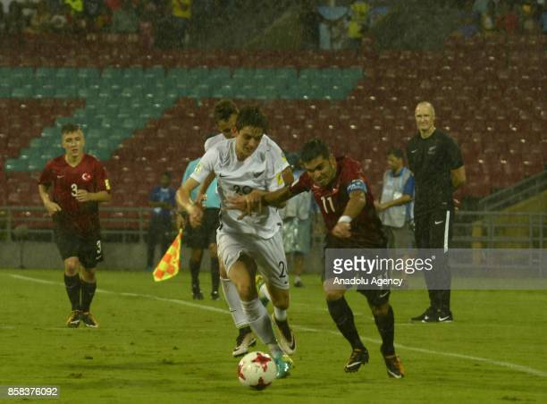 Recep Gul of Turkey U17 in action against Emlyn Gabriel Wellsmore of New Zealand U17 during the FIFA U17 World Cup India 2017 football match between...