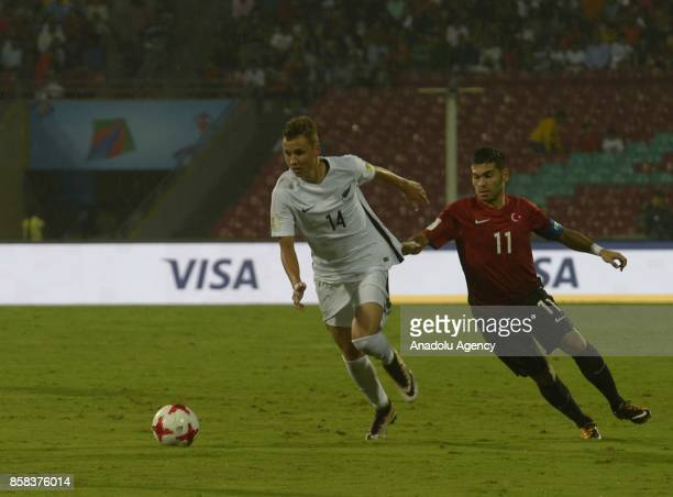 Recep Gul of Turkey U17 in action against Kingsley Poi Poi Sinclair of New Zealand U17 during the FIFA U17 World Cup India 2017 football match...