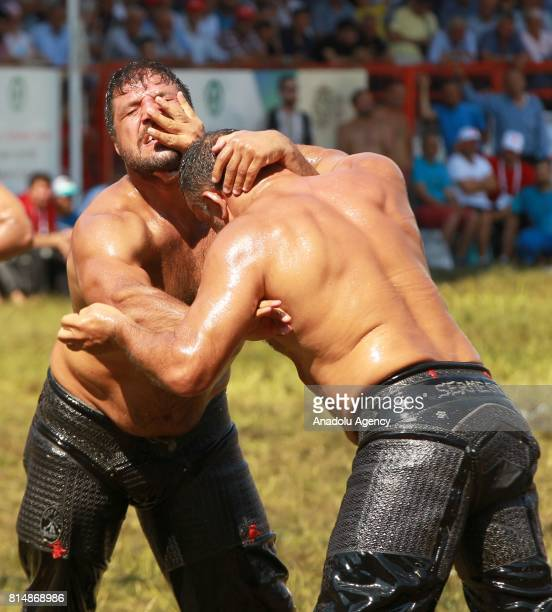 Recep Kara in action against Sermest Bulut during the first day of the 656th annual Kirkpinar Oil Wrestling Festival in Sarayici near Edirne Turkey...