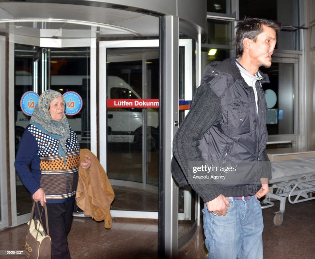 Recep Kaya (R) arrives at Akdeniz University Hospital shortly after receiving a phone call from face transplant specialists who have been looking for the right donor for him for some time on December 28, 2013 ospital, Turkey. Kaya, a twenty-one year old from Kirklareli town of north-western Turkey, will finally be able to look at his new face in the mirror in 2014 after Turkeys seventh face transplant operation to be carried out in the final days of the year.