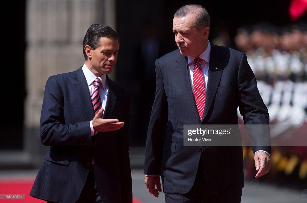 Recep Tayyip Erdogan president of Turkey walks next to Enrique Pena Nieto president of Mexico upon he arrives at Palacio Nacional for a meeting...