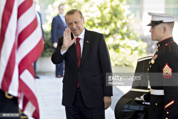 Recep Tayyip Erdogan Turkey's president waves to photographers after being greeted by US President Donald Trump not pictured at the West Wing of the...