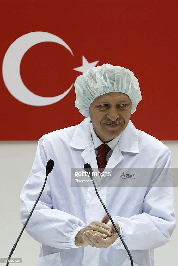 <a gi-track='captionPersonalityLinkClicked' href=/galleries/search?phrase=Recep+Tayyip+Erdogan&family=editorial&specificpeople=213890 ng-click='$event.stopPropagation()'>Recep Tayyip Erdogan</a>, Turkey's prime minister, applauds after speaking during a ceremony marking the shipment of Turksat AS's Turksat-4A communications satellite, manufactured by Mitsubishi Electric Corp., at the company's satellite production facility at Kamakura Works in Kamakura, Kanagawa Prefecture, Japan, on Wednesday, Jan. 8, 2014. Turksat AS is Turkey's state-owned satellite operator. Photographer: Kiyoshi Ota/Bloomberg via Getty Images