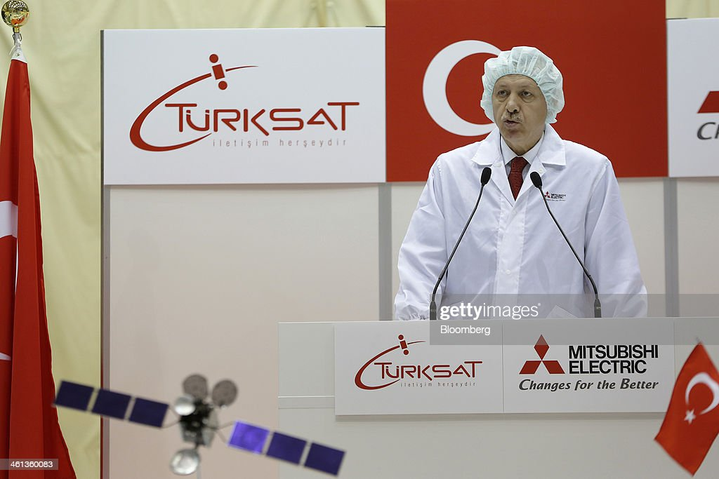 Recep Tayyip Erdogan, Turkey's prime minister, speaks during a ceremony marking the shipment of Turksat AS's Turksat-4A communications satellite, manufactured by Mitsubishi Electric Corp., at the company's satellite production facility at Kamakura Works in Kamakura, Kanagawa Prefecture, Japan, on Wednesday, Jan. 8, 2014. Turksat AS is Turkey's state-owned satellite operator. Photographer: Kiyoshi Ota/Bloomberg via Getty Images
