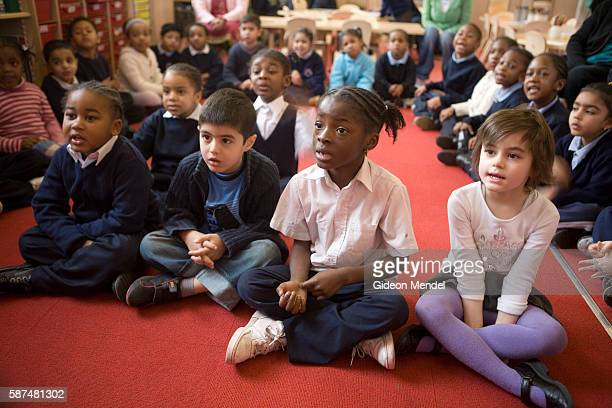 Reception Year pupils at Millfields Community School listen intently as their teacher tells a story during their morning 'carpet time' This is a...