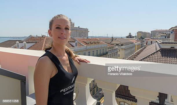 Receptionist Alexandra shows rooftops view from the balcony of the bedroom at CR7 Cristiano Ronaldo Suite of Pestana CR7 Lisboa Hotel on August 11...