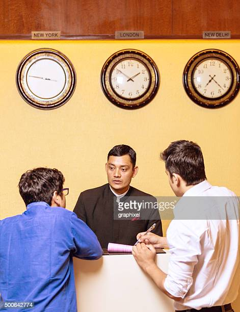 Receptionist in Hotel Greets Customers