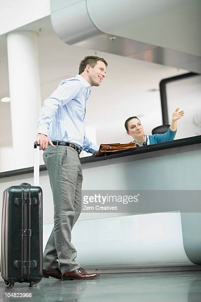 Receptionist showing the way