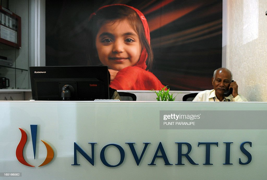 A receptionist sits in the front office of Novartis India in Mumbai on April 1, 2013. India's Supreme Court rejected a patent bid by Swiss drug giant Novartis in a landmark ruling that activists say will protect cheap generic drugs and save lives in developing nations.