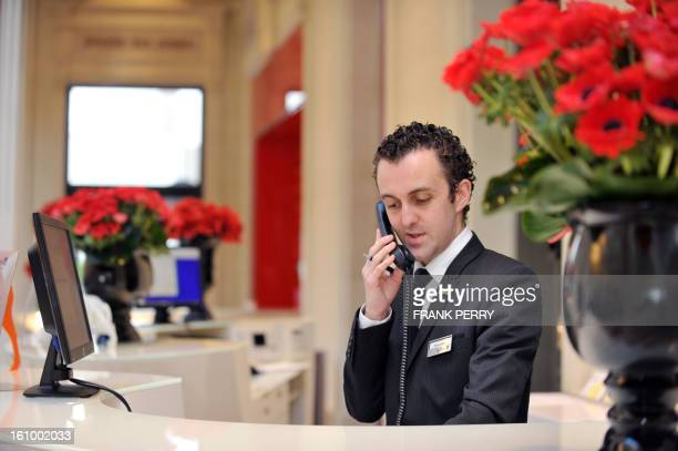 A receptionist speaks on the phone at the front desk of the Radisson Blu Hotel on February 8 2013 in Nantes western France AFP PHOTO FRANK PERRY