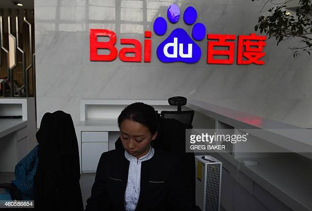 A receptionist works in the stillunderconstruction Baidu research and development center in Beijing on December 17 2014 Baidu China's leading search...