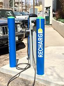 A recharge station for electric powered vehicles in a public parking lot in Denver Colorado