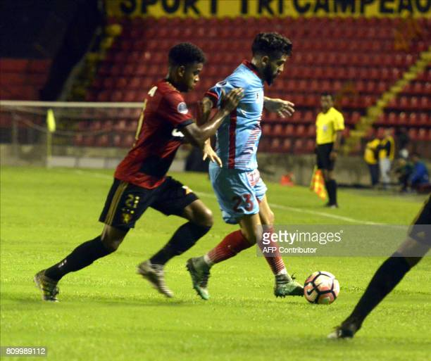 Recifes' Rithely and Arsenal's Federico Milo vie for the ball during their Sudamericana Cup football match in Recife Brazil on July 6 2017 ilo...