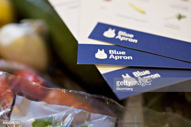 Recipe cards from a Blue Apron Holdings Inc mealkit delivery are arranged for a photograph in Tiskilwa Illinois US on Wednesday June 14 2017 Blue...