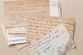 A collection of old recipe cards.  Some hand written, some typed, all show signs of age.  Some are more discolored than others.  The recipes you can see include chocolate fudge cake, raspberry jelly,