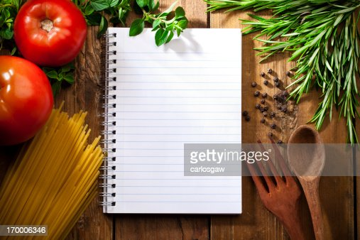 Recipe notepad surrounded by italian ingredients