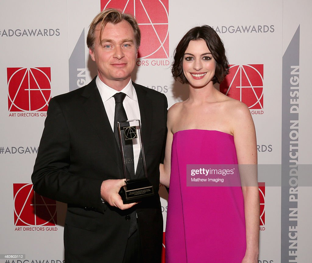 Recipient of Outstanding Contribution To Cinematic Imagery Christopher Nolan and presenter Anne Hathaway attend the 19th Annual Art Directors Guild...