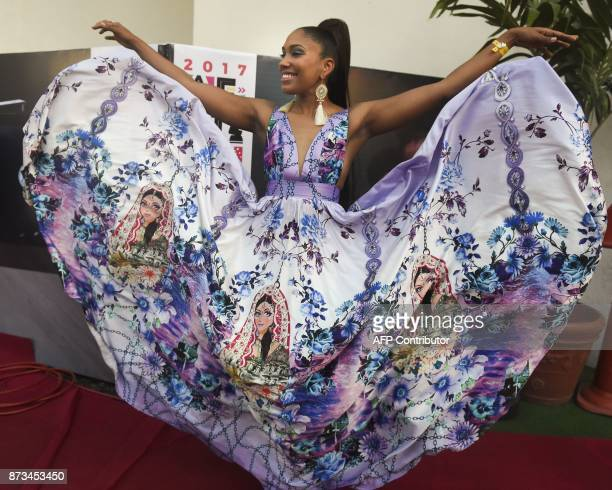 Recipient of the Best African Electro artist award Angolan singer Nsoki poses on the red carpet during the All Africa Music Awards in Lagos on...