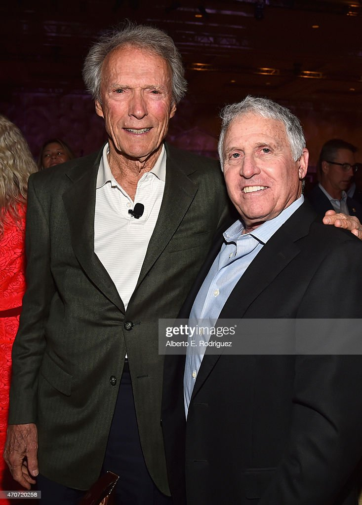 """Recipient of the Fandango Fan Choice award for Favorite Film of 2014, 'American Sniper,' Clint Eastwood (L) and President Domestic Distribution Warner Bros. Pictures Dan Fellman attend CinemaCon and Warner Bros. Pictures Present """"The Legend of Cinema Luncheon: A Salute to Clint Eastwood"""" at Caesars Palace during CinemaCon, the official convention of the National Association of Theatre Owners, on April 22, 2015 in Las Vegas, Nevada."""