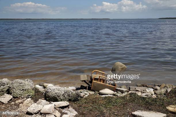 A recliner sits at the water's edge carried there by Hurricane Irma in the Big Pine Cove neighborhood September 15 2017 in Big Pine Key Florida Many...