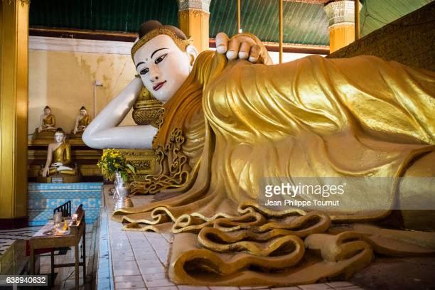 Reclining Buddha in a pavilion near Kyaik Than Lan Pagoda in Mawlamyine, Mon State, Southern Myanmar (Burma)
