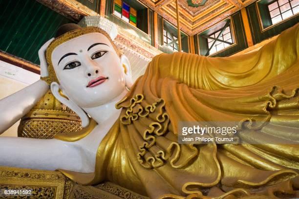 Reclining Buddha with Golden Robe in a pavilion near Kyaik Than Lan Pagoda in Mawlamyine, Mon State, Southern Myanmar (Burma)