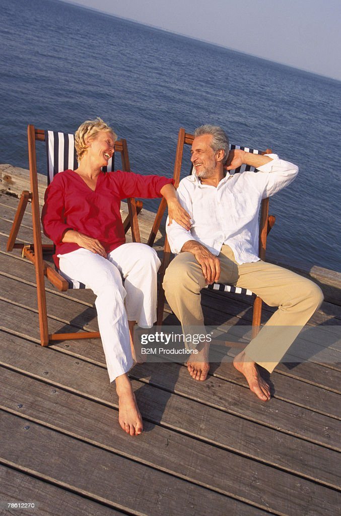 Reclining couple chatting