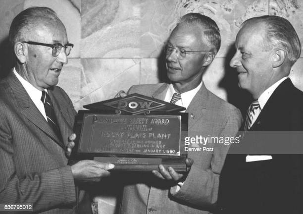 Recognition For Rocky Flats Dr Leland I Doan President of Dow Chemical Co presents special plaque to H L Langell manager of the Rocky Flats plant in...