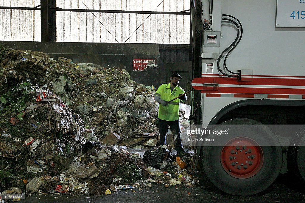 Recology worker dumps a load of compostable materials at the Recology transfer station on December 10 2010 in San Francisco California One year after...