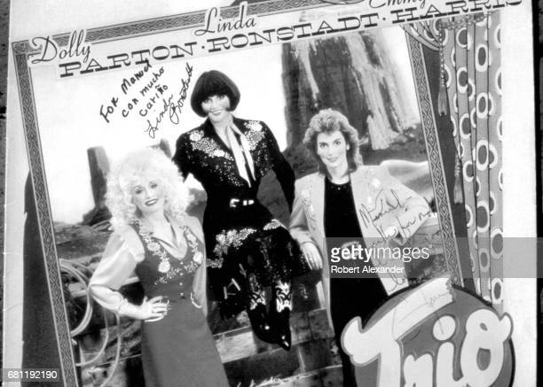 A 1997 record album featuring singers Dolly Parton Linda Ronstadt and Emmylou Harris is inscribed and autographed by the three singers The album...