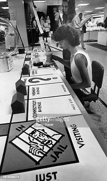 JUN 18 1974 JUN 20 1974 Record and Aid are aims of Monopoly Game Arvada High School students Debbie Kidd of 6627 Otis St and John Witt of 6405...