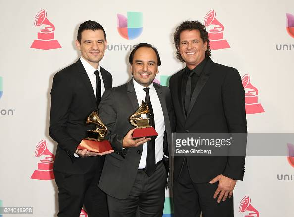 Record engineer/producer Luis Barrera Jr composer Andres Castro and recording artist Carlos Vives pose with the Record Of The Year award in the press...