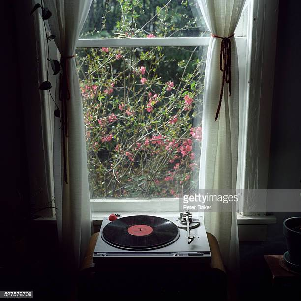 A record player in front of a window