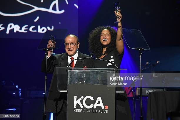 Record producer and honoree Clive Davis and Keep A Child Alive cofounder and singer Alicia Keys speak onstage during Keep A Child Alive's Black Ball...