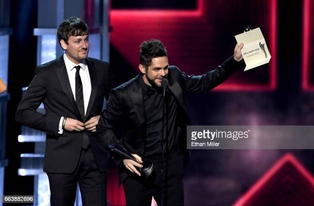 Record producer and songwriter Joe Spargur and recording artist Thomas Rhett accept the Song of the Year award for 'Die a Happy Man' onstage during...