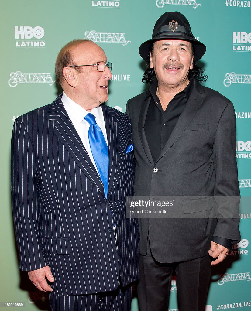 Record producer <a gi-track='captionPersonalityLinkClicked' href=/galleries/search?phrase=Clive+Davis&family=editorial&specificpeople=209314 ng-click='$event.stopPropagation()'>Clive Davis</a> and musician Carlos Santana attend the 'Santana De Corazon' screening at The Hudson Theatre on April 16, 2014 in New York City.