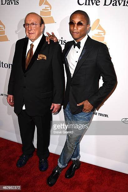 Record producer Clive Davis and recording artist Pharrell Williams attend the PreGRAMMY Gala and Salute To Industry Icons honoring Martin Bandier on...