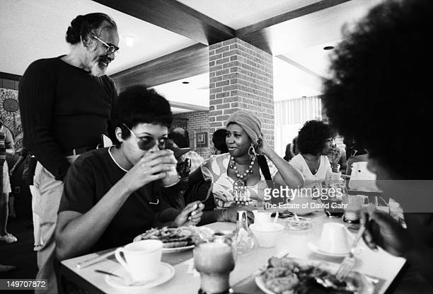 Record producer Jerry Wexler visits with soul singer Aretha Franklin at an event at the Newport Jazz Festival in July 1971 in Newport Rhode Island