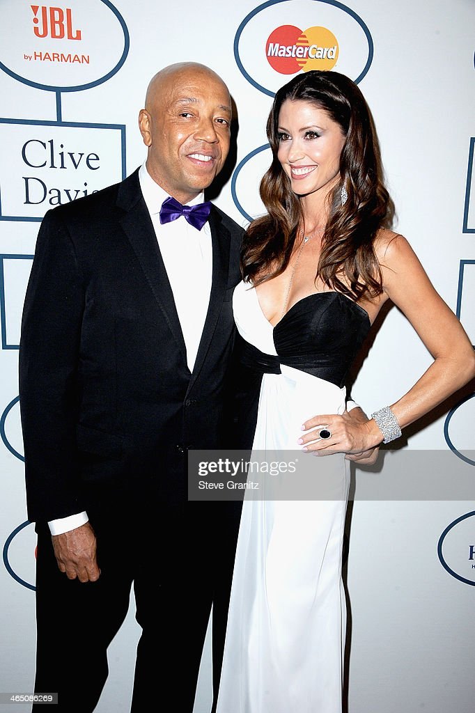 Record producer Russell Simmons (L) and actress Shannon Elizabeth attend the 56th annual GRAMMY Awards Pre-GRAMMY Gala and Salute to Industry Icons honoring Lucian Grainge at The Beverly Hilton on January 25, 2014 in Los Angeles, California.
