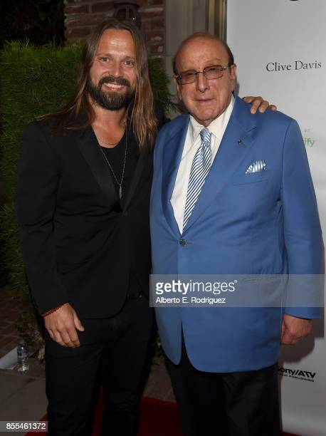 Record Producers Max Martin and Clive Davis attend City of Hope's Music Film and Entertainment Industry's Songs of Hope Event at Private Residence on...