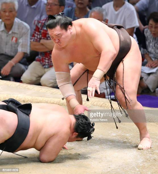 Recordbreaking grand champion Hakuho slams down ozeki Goeido at the Nagoya Grand Sumo Tournament in Nagoya central Japan on July 22 zeroing in on his...