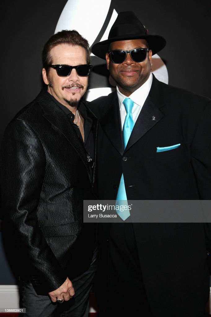 Recording Academy Chairperson of the Board George Flanigan and producer Jimmy Jam arrive at the 54th Annual GRAMMY Awards held at Staples Center on...
