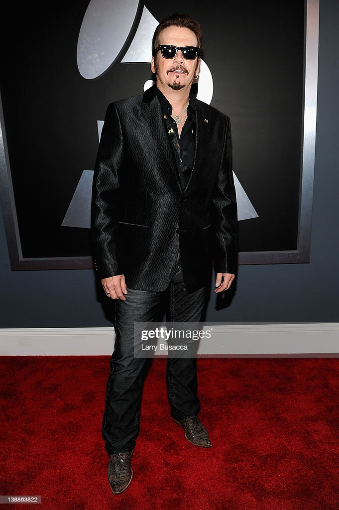 Recording Academy Chairperson of the Board George Flanigan arrives at the 54th Annual GRAMMY Awards held at Staples Center on February 12, 2012 in Los Angeles, California.